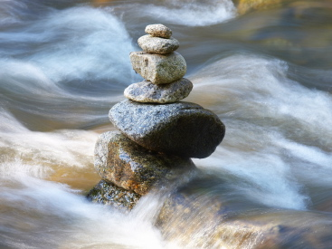 Stones surrounded by rushing water