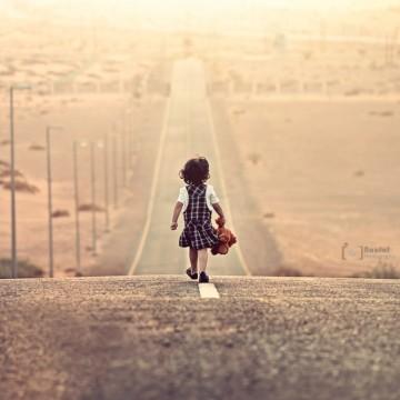 girl walking along road