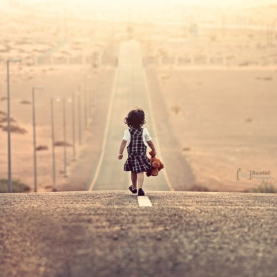 girl walking along road