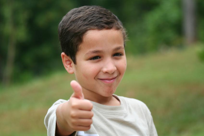 Young boy encouraging