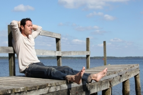 man deep relaxed breathing