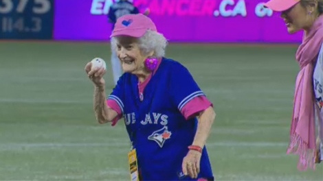Kitty Cohen throws first pitch
