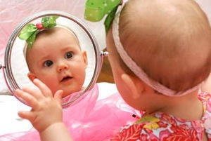 baby in mirror