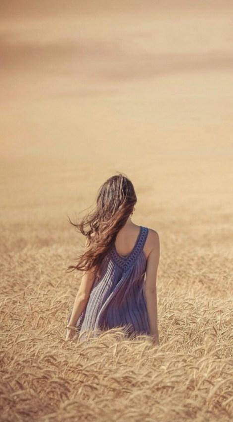 wind-wheat-back-woman-portrait