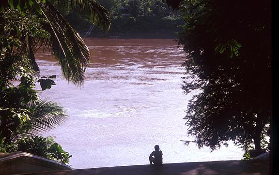 sitting on river bank