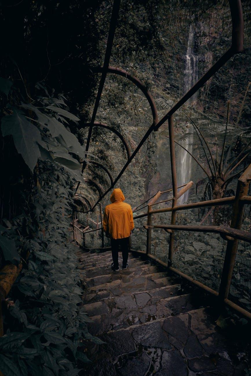 person wearing orange hoodie