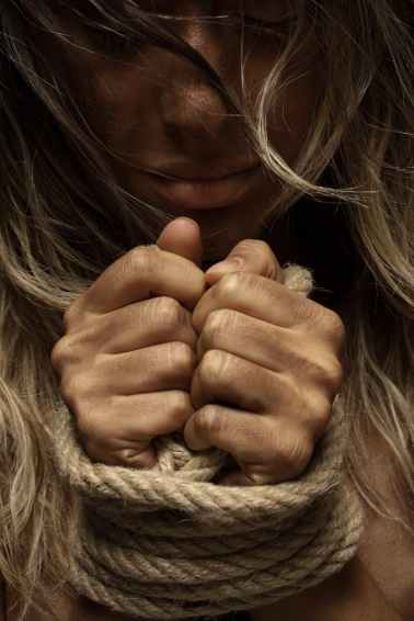 close up photo of woman with her hands tied with rope