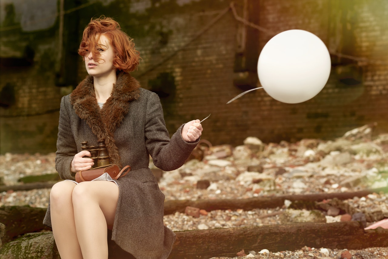 woman-holding-white-balloon-3064615