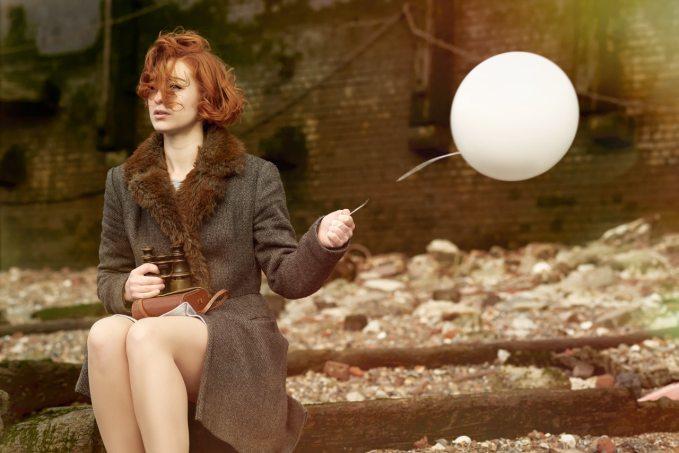 woman-holding-white-balloon-3064615